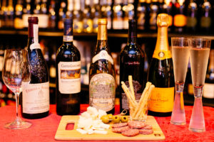 Bill - wine bottles and cheese plate